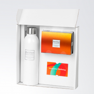 The Complete Defence Gift box, by Fortified Immunity, open, displaying products, positioned beside a limited edition Fortified Immunity reusable bottle.