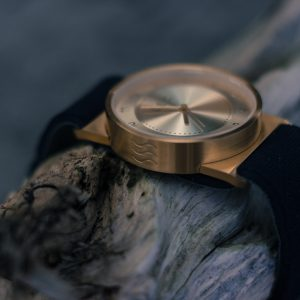 Gold Coast upcycled watch with a bronze finish and a strap made out of recycled wetsuits.