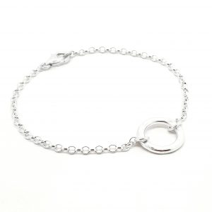 Handmade bracelet with a small sterling silver flat hammered ring