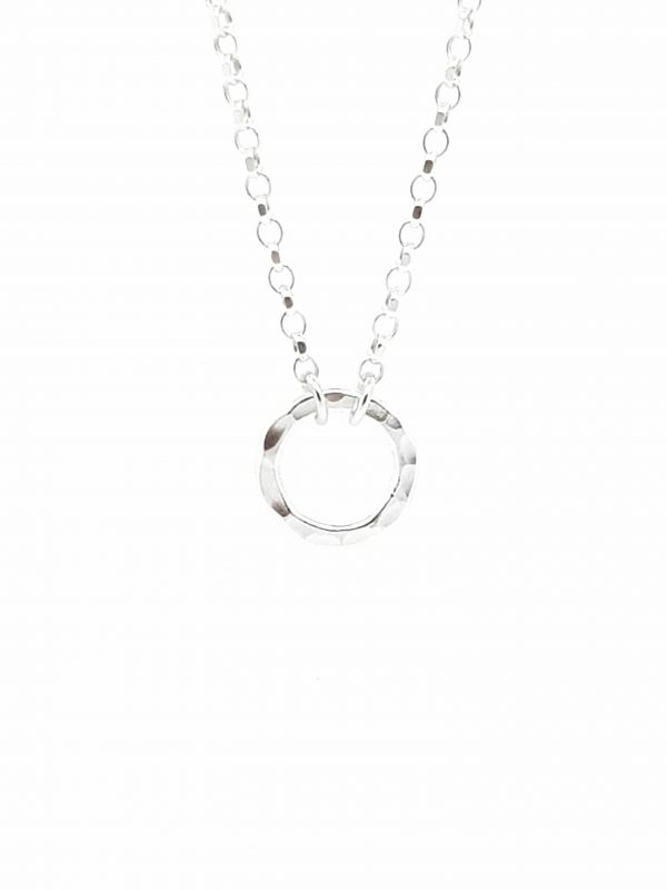 Contemporary necklace handmade with a small sterling silver flat hammered ring