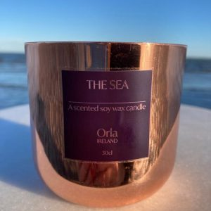 Copper candle in the sea scent taken on the beach