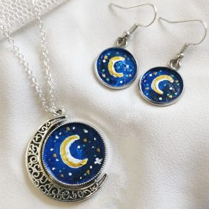 Handpainted silver full moon necklace and earrings on white background