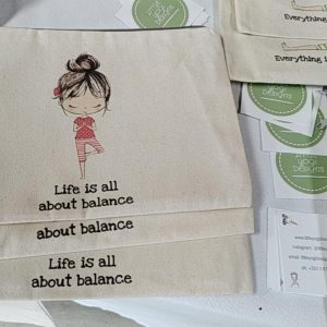 Flat view of the organic cotton multi-purpose lily pouch in life is all about balance
