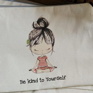 Flat close up view of the lily pouch in be kind to yourself