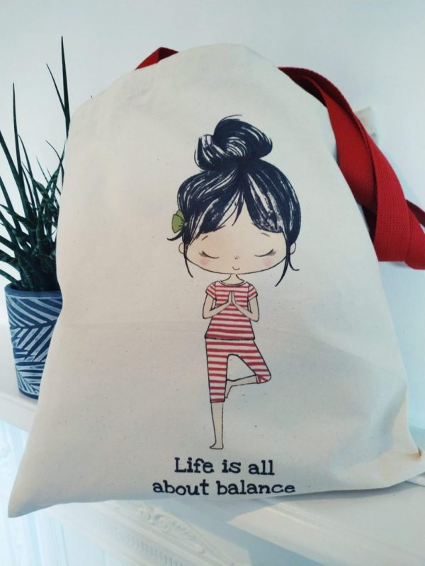 Closeup of the organic cotton lily tote in the style life is all about balance