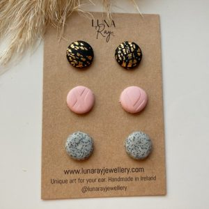 Cardboard pack of pink, granite and black gold leaf stud earrings