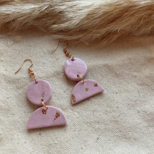 pink clay earrings with half moons dangling and rose gold hooks