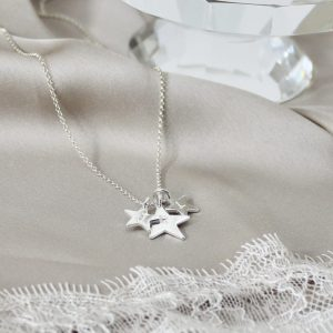 Sterling Silver Star Necklace on Silk Background