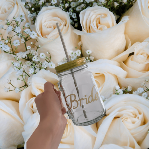 Drinking Glass with Bride with white roses in background written on it