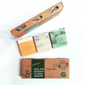 Three solid soap bars with sustainable cardboard packaging