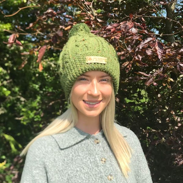 Young woman wearing a green hat.
