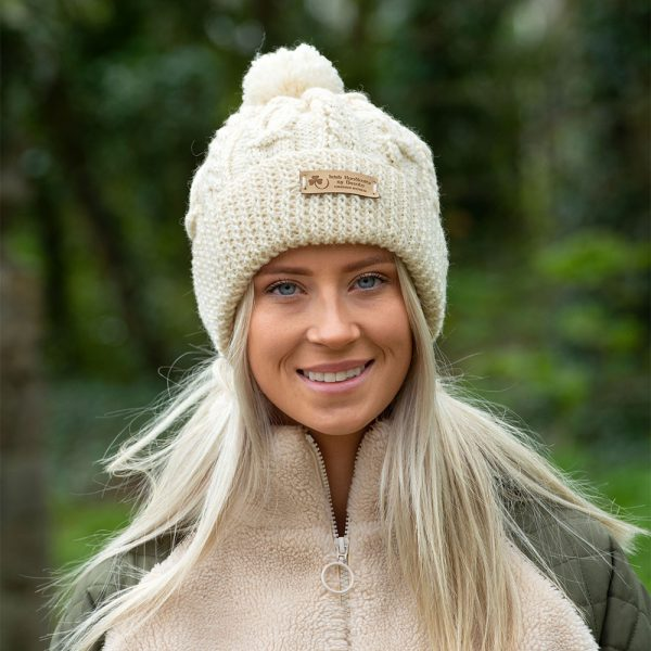 Young woman wearing a cream hat.