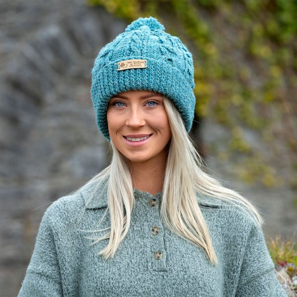 Young woman wearing a turquoise hat.