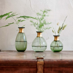 green vase with brass neck