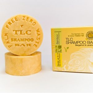 Yellow shampoo bar in sustainable yellow cardboard package