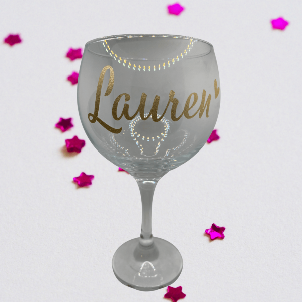 gin glass with Lauren written o it and pink confetti in the background