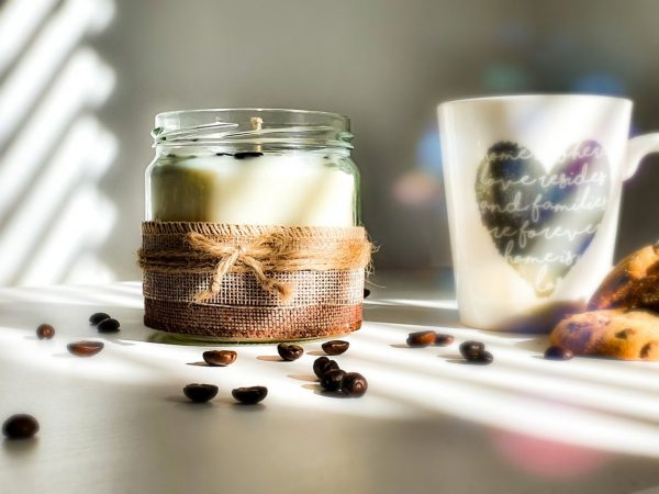 eco candle displayed with coffee beans and coffee cup