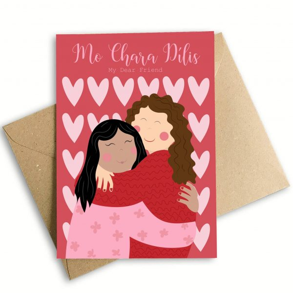 red card with two people hugging and pink hearts