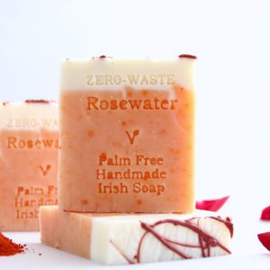 Aesthetically pleasing picture of rosewater bar of soap with rose petals