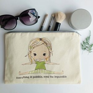everything is possible pouch with sun glasses and three brushes in back round