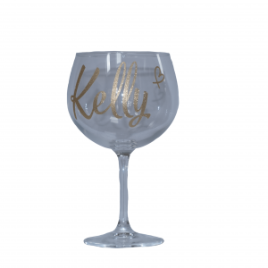 Gin glass with Kelly written in gold on it.