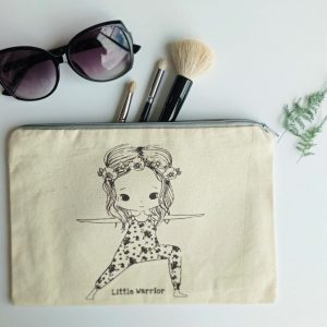 little warrior pouch with sun glasses and three make up brushes in backround