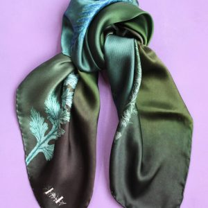 Green necktie with fern pattern and made of silk.
