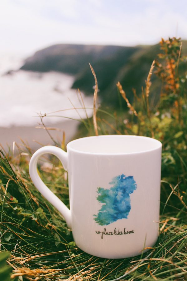 White china mug with an illustration of the map of Ireland and the words 'no place like home'.