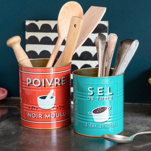 A red pepper tin and a turquoise salt tin in french with utensils in them.